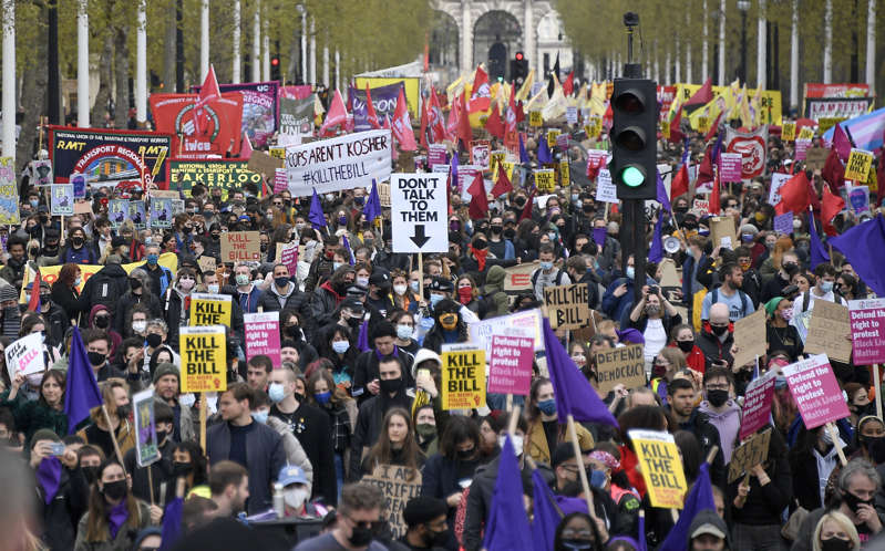 Protestors march down the Mall in central London during a 'Kill the Bill' protest on Saturday, May 1, 2021. The demonstration is against the contentious Police, Crime, Sentencing and Courts Bill, which is currently going through Parliament and would give police stronger powers to restrict protests. (AP Photo/Alberto Pezzali)