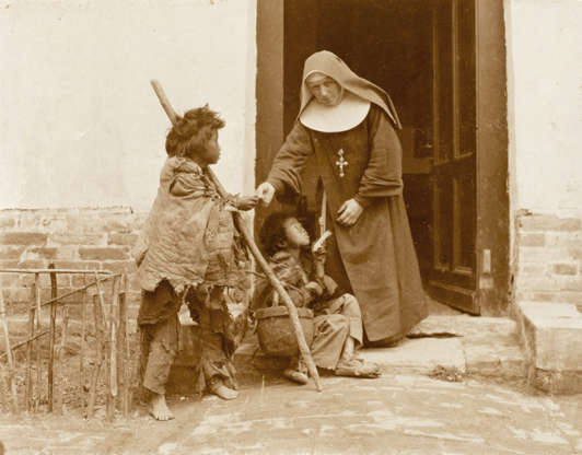 """Slide 3 of 31: This photo, believed to be from the late 1890s or early 1900s, shows a Catholic nun in Shanghai giving alms to a begging child. The photo was taken """"before or shortly after"""" the Boxer Rebellion, a nationalist revolt in 1900 that attempted to overturn the Chinese imperial regime and drive all foreigners from the country. According to Encyclopedia Britannica, the rebels also attacked both Chinese and foreign Christians. As many as 100,000 people died in the revolt; according to the encyclopedia, """"the great majority of those killed were civilians, including thousands of Chinese Christians and approximately 200 to 250 foreign nationals (mostly Christian missionaries)."""""""