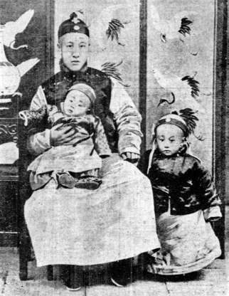 """Slide 23 of 31: In this photo taken around 1909, four-year-old Emperor Puyi (right) stands next to his father and baby brother. After the Chinese revolution of 1911-12, the child emperor was forced to abdicate, ending the 2,000-year-old Chinese imperial system. Twelve years later, he fled the Forbidden City and reached the Japanese concession (colony) at Tianjin. From 1934 to 1945, he served as emperor of Manchukuo, the puppet state of imperial Japan in northeastern China. Captured by the Soviet army at the end of the Second World War, he was sent back to China in 1950 to face trial for war crimes. He was pardoned in 1959 and lived out his days working in Beijing's botanical garden, an ordinary citizen who, as the South China Morning Post forlornly notes, """"had to buy a ticket to enter his old home."""""""