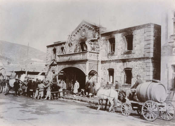 Slide 26 of 31: This photo shows damage to a Russian administrative building in the northeastern Chinese city of Port Arthur (later Dalian) during the Russo-Japanese War in 1904. Russia secured a 25-year lease on the port in 1898, setting up a confrontation with Japan as Britain, France and Germany also staked claims on Chinese territory. In February 1904, at Port Arthur, the main Japanese fleet took Russian forces by surprise, setting off the Russo-Japanese War. In early January 1905, Russia surrendered Port Arthur. Japan eventually defeated Russia, the first modern victory of an Asian military power over a European one.
