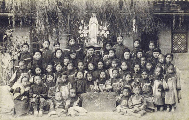 """Slide 9 of 31: This photo from the early 1900s shows orphans at a Catholic mission in Gansu province, north-central China. According to the China Online Study Centre, a website devoted to Christianity in China, Gansu is one of China's most culturally and religiously diverse provinces. Gansu is home to one of the country's largest Buddhist monasteries, but has also had a Christian presence for centuries. Missions like this one first appeared in Gansu in the 19th century. Although all forms of religious belief are officially discouraged in present-day China, the study centre reports that """"since the 1980s, churches have reopened and grown significantly."""""""
