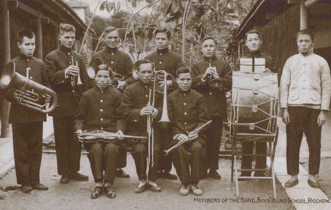 """Slide 2 of 31: This photo from the early 1910s shows band members from the Fuzhou School for the Blind. According to the University of Bristol (which maintains an online archive of historical photos of China), the Church Missionary Society Blind Boys' School was founded in 1898 in Fuzhou, southeastern China, by Australian nurse and missionary Amy Oxley Wilkinson. Music ensembles from the school """"later began touring Fujian province, then [travelled] to other parts of China, and finally to the UK,"""" according to the university."""