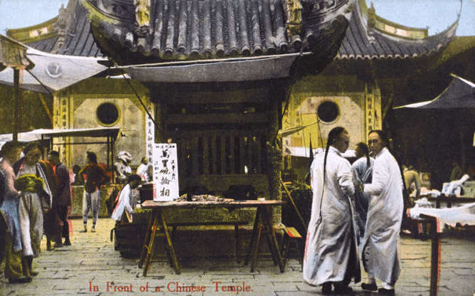 """Slide 20 of 31: This colourized postcard from the early 20th century shows people gathered around a temple in Shanghai. In 1842, as part of the treaty that ended the first Opium War between China and Britain, Shanghai was """"opened for unrestricted foreign trade"""" according to Encyclopedia Britannica. """"The British, French, and Americans took possession of designated areas in the city within which they were granted special rights and privileges,"""" the encyclopedia explains. These colourized postcards of Chinese urban life were produced for travellers and expatriate employees of foreign companies to mail home."""