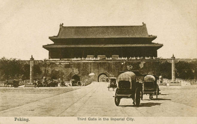 """Slide 22 of 31: This postcard shows horse-drawn carriages in front of the gate of the Forbidden City in Beijing (then Peking). The Forbidden City is a city within a city made up of more than 90 palace compounds, which housed the imperial court from its completion in 1420 until the expulsion of China's last emperor, Puyi, in 1925. According to online learning site Khan Academy, the court """"determined the occupants of the Forbidden City strictly according to their positions in the imperial family,"""" with buildings designed differently based on the social status of their inhabitants. Today, it's China's most visited tourist attraction."""