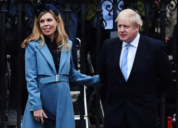 Carrie Symonds, Boris Johnson are posing for a picture: Pic: Chris J Ratcliffe/Getty Images)