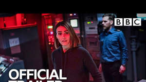 Suranne Jones standing in front of a television: Subscribe and 🔔 to OFFICIAL BBC YouTube 👉 https://bit.ly/2IXqEIn Stream original BBC programmes FIRST on BBC iPlayer 👉 https://bbc.in/2J18jYJ  The mysterious disappearance of a Scottish fishing trawler and a death on-board the submarine HMS Vigil bring the police into conflict with the Navy and British security services. DCI Amy Silva (Suranne Jones) and DS Kirsten Longacre (Rose Leslie) lead an investigation on land and at sea into a conspiracy that goes to the very heart of Britain's national security.  Vigil | Trailer | BBC  #BBC #Vigil #BBCiPlayer  All our TV channels and S4C are available to watch live through BBC iPlayer, although some programmes may not be available to stream online due to rights. If you would like to read more on what types of programmes are available to watch live, check the 'Are all programmes that are broadcast available on BBC iPlayer?' FAQ 👉 https://bbc.in/2m8ks6v.
