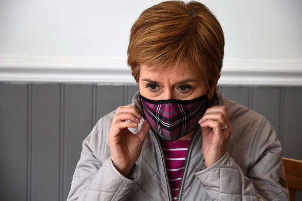 a person posing for the camera: Scotland's First Minister and leader of the Scottish National Party (SNP), Nicola Sturgeon in a cafe in Troon during campaigning for the Scottish Parl
