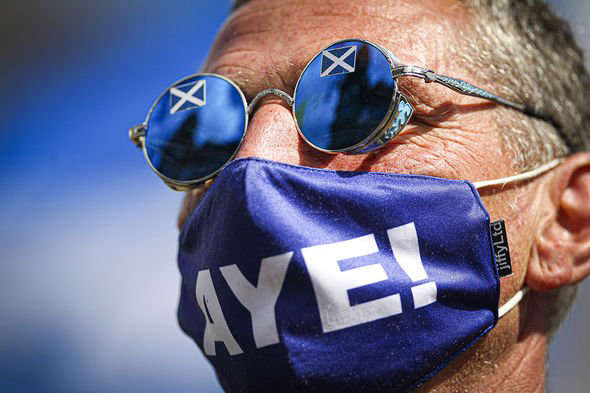 a close up of a man wearing sunglasses: All under one banner members take part in a static Indy Ref2 rally at George Square on May 1, 2021 in Glasgow, Scotland