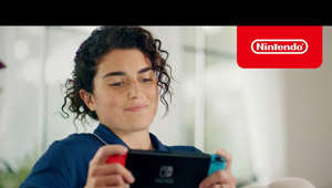 a person looking at the screen of a cell phone: Create your own special moment with Animal Crossing: New Horizons, available exclusively on the Nintendo Switch and Nintendo Switch Lite systems, starting at $199. ESRB Rating: Everyone with Comic Mischief  Learn more: https://www.nintendo.com/switch/    #NintendoSwitch #AnimalCrossing #ACNH  Subscribe for more Nintendo fun! https://goo.gl/HYYsot