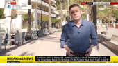 a person that is standing in the street: Holidays: Magaluf is 'like a ghost town' says expert