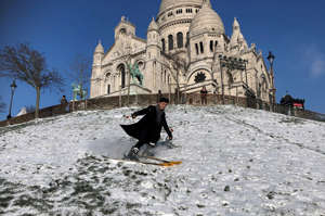 Skier Nathan practices ski down the Montmartre hill near the Sacre Coeur Basilica in Paris as winter weather with snow and cold temperatures hits a large northern part of the country, France, February 10, 2021. REUTERS/Antony Paone     TPX IMAGES OF THE DAY