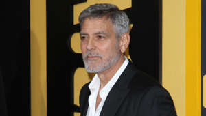 George Clooney wearing a suit and tie