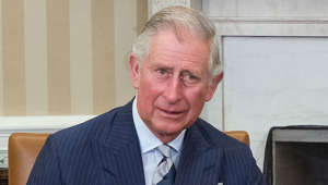 Prince Charles wearing a suit and tie