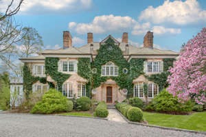 a large brick building with grass in front of a house: Compass Real Estate lists a home in Mount Kisco, N.Y., for $2.7 million.