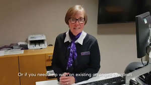 a person standing in front of a desk: NatWest explain how they are helping during the pandemic