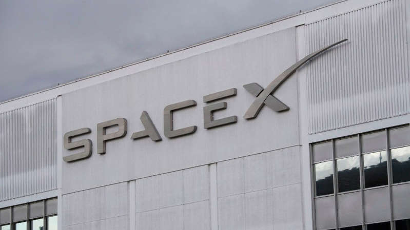 a sign on the side of a building: SpaceX headquarter