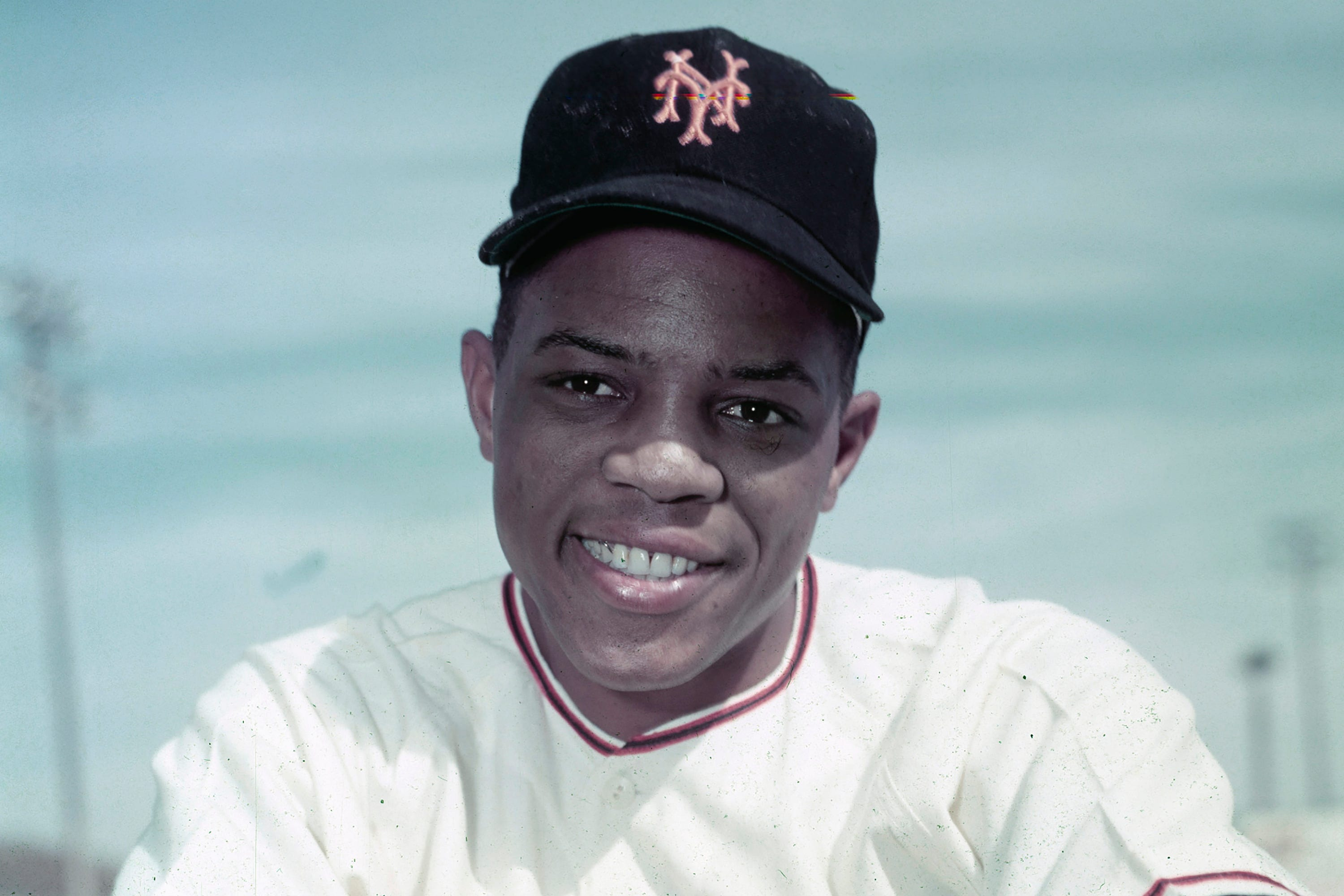 Willie Mays wearing a hat