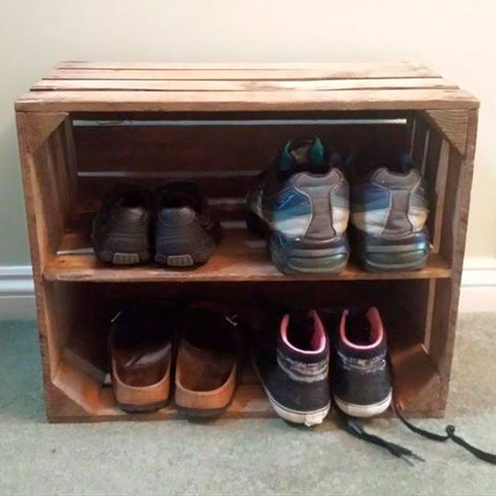 Slide 3 of 10: When it comes to coat closet organization, create a DIY stackable shoe rack that your family can store their shoes in with old empty wood crates. (You can usually find wooden crates at your local thrift store for pretty cheap.) Once you have a few, you can stack them on top of each other and beside each other in any shape you want. If you like the rustic farmhouse style they give off you don't even need to paint them. Not up to DIYing? Then consider this Shabby Chic Wooden Shoe Rack option from Etsy. Talk about a cute idea for a shoe holder! Shop Now
