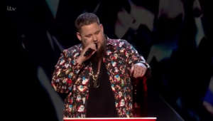 a person posing for the camera: BRIT Awards: Rag n Bone Man's mic is cut out during speech