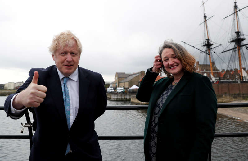Britain's Prime Minister Boris Johnson and newly elected MP for Hartlepool Jill Mortimer pose for a photo at Jacksons Wharf Marina in Hartlepool following local elections, Britain, May 7, 2021. REUTERS/Lee Smith