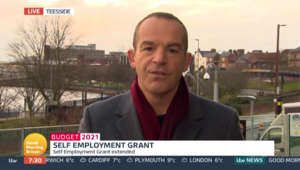 Martin Lewis holding a sign: Budget 2021: Martin Lewis discusses changes to SEISS grant