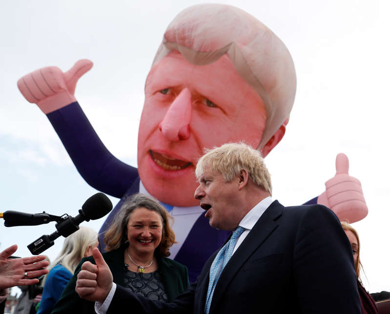 Britain's Prime Minister Boris Johnson and newly elected MP for Hartlepool Jill Mortimer speak, with an inflatable figure depicting Johnson in the background, at Jacksons Wharf Marina in Hartlepool following local elections, Britain, May 7, 2021. REUTERS/Lee Smith