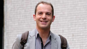 Martin Lewis wearing a suit and tie smiling at the camera: Martin Lewis provides advice on mortgage overpayments