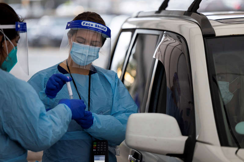 A nurse collects COVID-19 test samples at the Bondi drive-through testing clinic on May 05, 2021 in Sydney, Australia.
