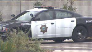 a car parked in front of a building: Fresno Police Department releases crime stats