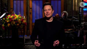 Elon Musk standing in a room: Tesla CEO Elon Musk shows off his funnier side on 'Saturday Night Live'
