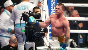 Saul Alvarez standing in front of a crowd: Boxing: Canelo celebrates victory over Saunders