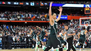 a person standing in front of a crowd: Tom Izzo is heading to his seventh Final Four after Michigan State took down Louisville, 76-70, in overtime. Travis Trice led the Spartans with 17 points, five rebounds and five assists in the win.  Watch highlights, game recaps, and much more from the 2015 NCAA Division I Men's Basketball Tournament on the official NCAA March Madness YouTube channel. Subscribe now to be updated on the latest videos: http://www.youtube.com/marchmadness?sub_confirmation=1  Connect with March Madness: Follow March Madness on Twitter: https://twitter.com/marchmadness Like March Madness on Facebook: https://www.facebook.com/NCAAMarchMadness Follow March Madness on Instagram: https://instagram.com/marchmadness