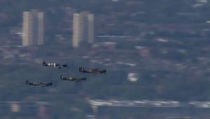 a plane flying over a city: Battle of Britain: RAF Spitfires fly over London for anniversary