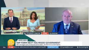 a screen shot of Ian Blackford in a suit and tie: GMB: Ian Blackford grilled by Susanna Reid over SNP pledge