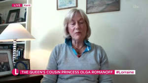 a woman standing in a room: Princess Olga Romanoff discusses her house tours