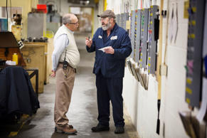 Factory worker and manager having a conversation
