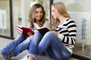 Two teenager school girls with books