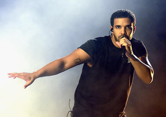 Slide 1 of 53: INDIO, CA - APRIL 12: Rapper Drake performs onstage during day 3 of the 2015 Coachella Valley Music & Arts Festival (Weekend 1) at the Empire Polo Club on April 12, 2015 in Indio, California. (Photo by Kevin Winter/Getty Images for Coachella)