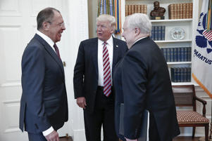 U.S. President Donald Trump meets with Russian Foreign Minister Sergey Lavrov, left, next to Russian Ambassador to the U.S. Sergei Kislyak at the White House in Washington, Wednesday, May 10, 2017. Trump on Wednesday welcomed Vladimir Putin's top diplomat to the White House for Trump's highest level face-to-face contact with a Russian government official since he took office in January.