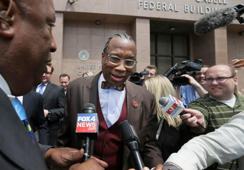 Reporters try to interview Dallas County Commissioner John Wiley Price as he exits federal court in downtown Dallas, Friday, April 28, 2017.