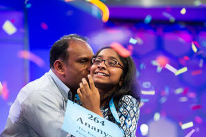 Ananya Vinay, 12, from Fresno, Calif., is kissed by her father Vinay Sreekumar moments after winning the 90th Scripps National Spelling Bee in Oxon Hill, Md., on June 1.