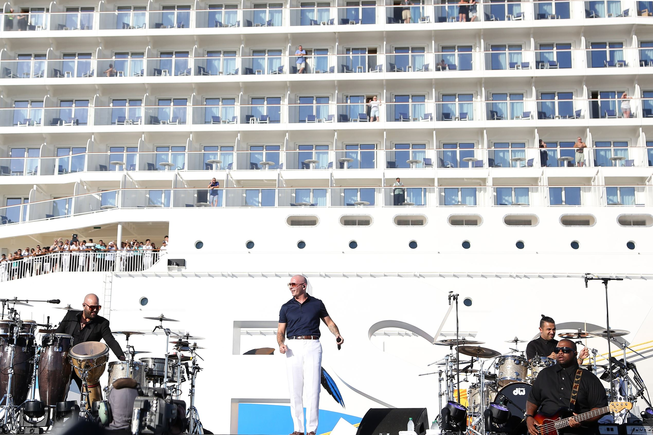 Slide 22 of 31: MIAMI, FL - NOVEMBER 09: Armando Christian Perez 'Pitbull' performs onstage at the Christening Ceremony for Norwegian Cruise Line's newest ship Norwegian Escape at Port Miami on November 9, 2015 in Miami, Florida. (Photo by Alexander Tamargo/Getty Images for Norwegian Cruise Line)