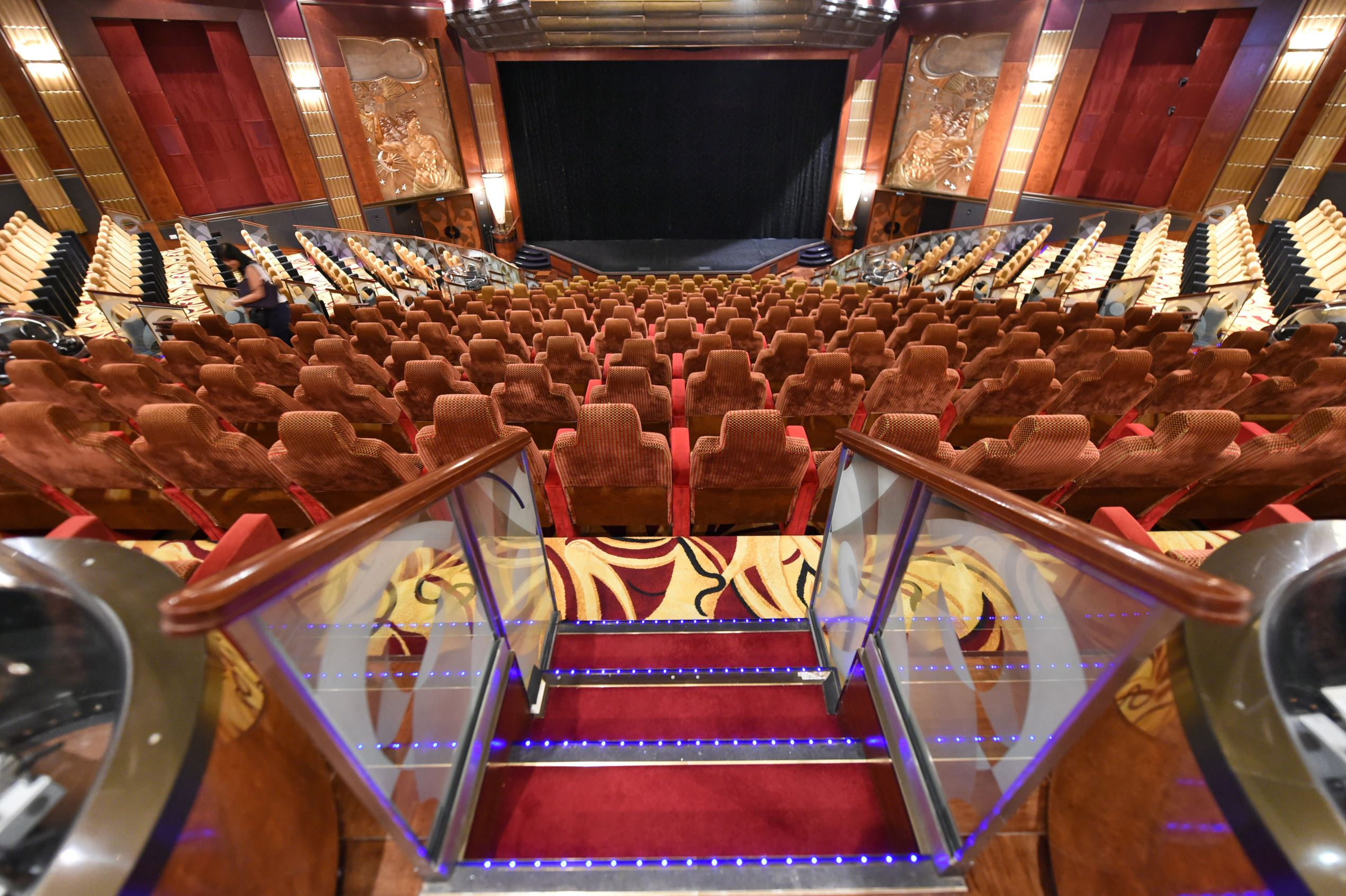 Slide 14 of 31: A view of the cinema theatre inside the world's biggest cruise liner ''Queen Mary 2'' docked at the Marina Bay Cruise Centre in Singapore on February 13, 2015. The Queen Mary 2, known as the grandest ocean liner arrived in Singapore on February 13 for her annual visit as part of an around the world voyage from Southampton. AFP PHOTO / ROSLAN RAHMAN (Photo credit should read ROSLAN RAHMAN/AFP/Getty Images)