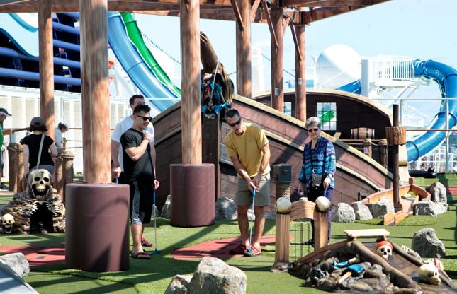 Διαφάνεια 16 από 24: Passengers play mini-golf in the sports complex on board the Norwegian Getaway, the newest ship from Norwegian Cruise Lines on March 1, 2014, in Miami. (Marsha Halper/Miami Herald/MCT via Getty Images)