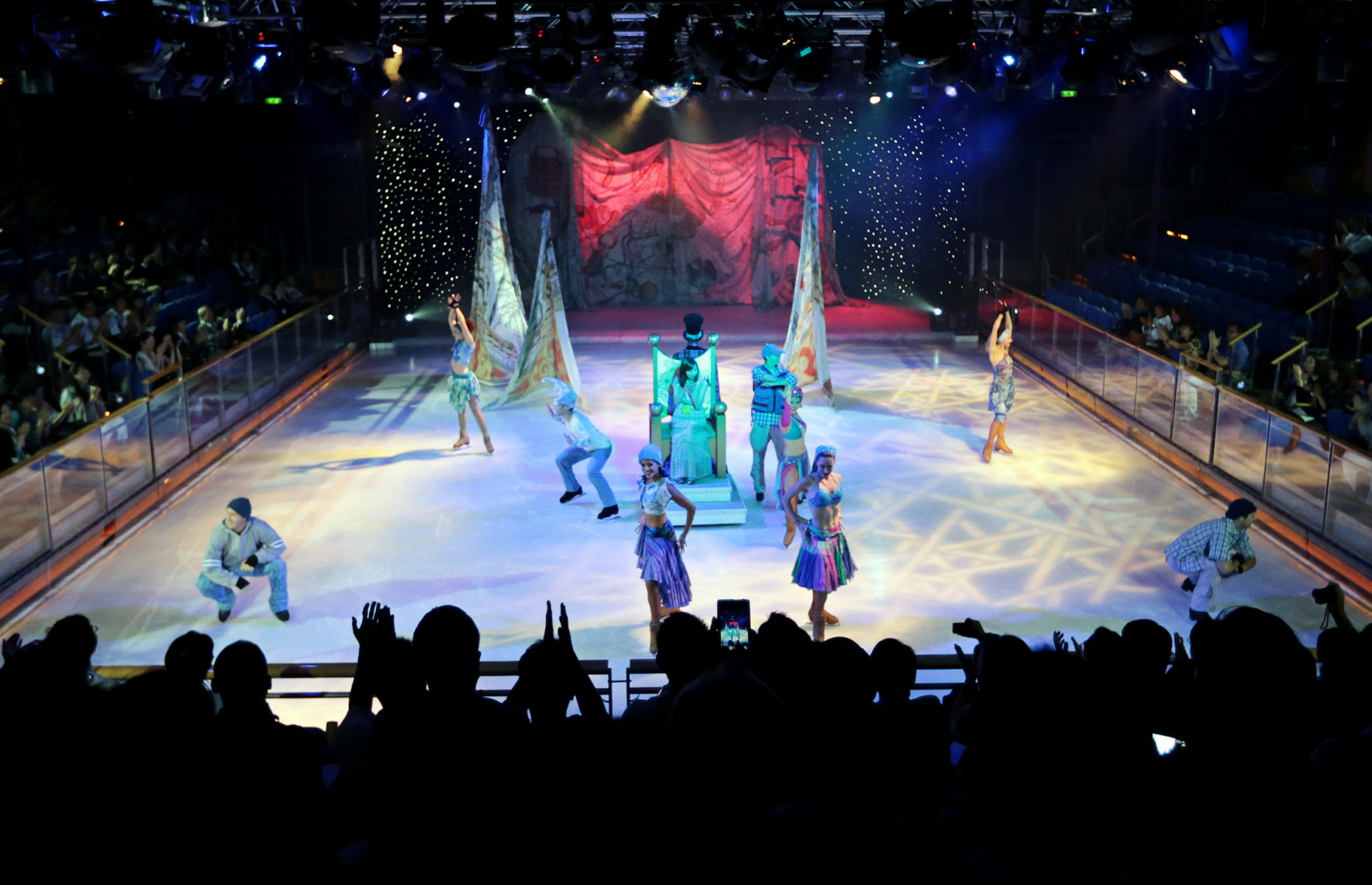 Slide 3 of 31: Skaters present a complimentary ice-skating show at the Royal Caribbean International's mega-ship, the Voyager of the Seas, is lit as it is displayed at a shooping street of the ship, berthed at the Ohi wharf in Tokyo, Japan, on Saturday, September 14, 2013. Photographer: Yuriko Nakao/Bloomberg