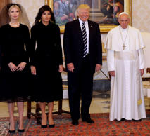 Pope Francis poses with U.S. President Donald Trump his wife Melania and Ivanka Trump during a private audience at the Vatican.
