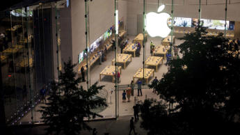 Consumers Shop At An Apple Inc. Store Ahead Of Earnings Figures