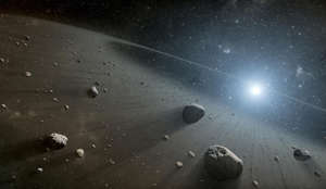 Nasa undated handout artist's impression of the asteroid belt surrounding the star Vega, the second brightest star in the northern night sky, which may have a family of planets similar to the Sun's, say scientists.