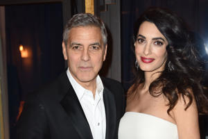 PARIS, FRANCE - FEBRUARY 24: George Clooney and Amal Clooney attend the Cesar Dinner at Le Fouquet's on February 24, 2017 in Paris, France. (Photo by Stephane Cardinale - Corbis/Getty Images)