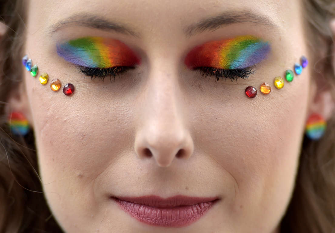 Slide 38 of 57: A participant with her eyes rainbow colors maked up takes part at the annual Belgian LGBT Pride Parade in central Brussels, Belgium May 20, 2017. REUTERS/Eric Vidal TPX IMAGES OF THE